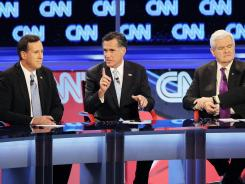 Republican presidential candidates Rick Santorum, Mitt Romney and Newt Gingrich participate during a debate sponsored by CNN and the Republican Party of Arizona at the Mesa Arts Center.