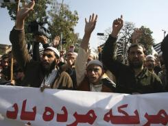 Pakistani religious students chant anti-American slogans at a rally in Islamabad condemning the burning of Qurans in Afghanistan by U.S. troops.