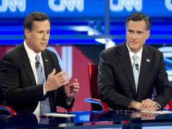 Rick Santorum and Mitt Romney participate in a GOP debate in Mesa, Ariz., on Wednesday.
