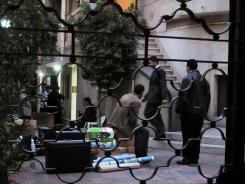 Egyptian police raid a non-governmental organization office Dec. 29 in Cairo.