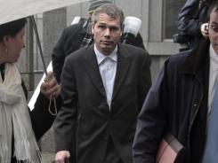Shepard Fairey, center, leaves federal court with his lawyers after he entered a guilty plea on a misdemeanor charge on Friday.