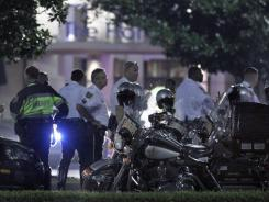 Police gather late Thursday outside the Florida Mall in Orlando after more than 100 sheriff's deputies in riot gear broke up an out-of-control crowd waiting to buy a new Nike basketball shoe.