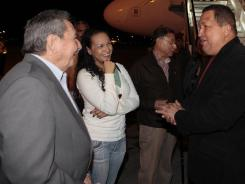 Venezuela's President Hugo Chavez, right, accompanied by one of his daughters, Rosa, is welcomed by Cuba's President Raul Castro, left, upon his arrival to Havana on Friday.