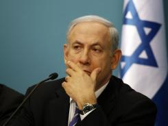 Israeli Prime Minister Benjamin Netanyahu gestures as he speaks during a press conference at his Jerusalem office on the economic situation on Wednesday.