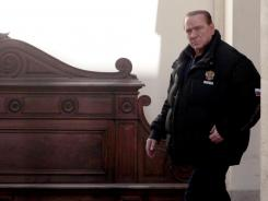 Former Italian Premier Silvio Berlusconi leaves his residence of Palazzo Grazioli in Rome Saturday.