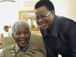 Former South African President Nelson Mandela and his wife Graca Machel after they cast an early ballot in 2011.