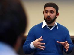 New York University Chaplin Khalid Latif speaks to students at NYU's Islamic Center on Friday during a discussion about NYPD surveillance.