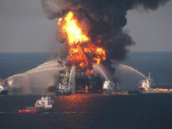 Fire boat response crews spray water on the burning remnants of BP's Deepwater Horizon offshore oil rig on April 21, 2010.