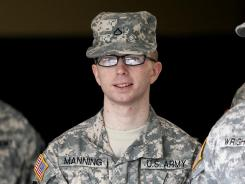 Army Pfc. Bradley Manning is escorted from a courthouse in Fort Meade, Md., on Dec. 22, 2011.