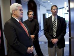 Newt Gingrich waits to be introduced during a campaign stop in Nashville on Monday.