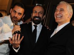 Peyman Moadi, left, with Asghar Farhadi, center, and Mahmoud Kalari at the Governor's Ball after the 84th Annual Academy Awards on Sunday.