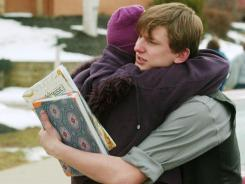 Nancy Norsic, left, hugs her son after being reunited following a shooting on Monday at Chardon High School.