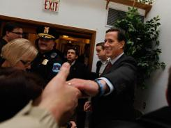 Rick Santorum greets people during a campaign stop Sunday in Davison, Michigan.