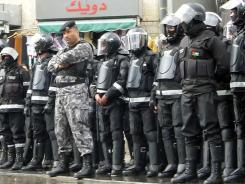 Security forces stand in downtown Amman during a protest on Feb. 24.