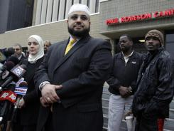 Attorney Nadia Kahf, left, stands with Mohamed Elfilali of the Islamic Center of Passaic County during a news conference in Newark to address NYPD spying.
