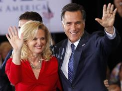 Mitt and Ann Romney wave to supporters in Novi, Mich., on Tuesday.