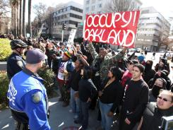 Occupy protesters shout at a pro-white group as it holds a demonstration at the Capitol in Sacramento on Monday.