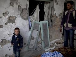 Residents' house was wrecked in clashes between the Free Syrian Army and government forces.