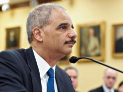 Attorney General Eric Holder testifies on Capitol Hill Tuesday.