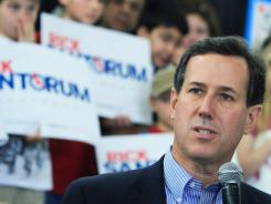 Rick Santorum speaks during a rally Thursday in Atlanta. He picked up 14 delegates in Michigan Tuesday even though he lost the statewide vote.