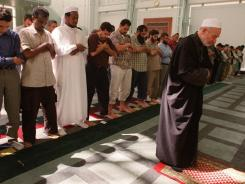 Imam Omar Abu Namous, right, leads a prayer service at the Islamic Center of New York. A new study finds New York has more mosques than any other state in the U.S.