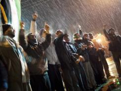 Free Syrian Army supporters chant anti-government slogans Wednesday on the outskirts of Idlib, Syria.