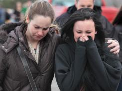 Chardon High School: Student Ava Polaski, right, with her mother after Monday's shooting.