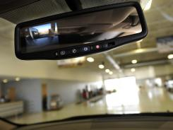A rear-view camera image is displayed in the mirror of a Chevrolet Traverse at Freeland Chevrolet on Thursday in Nashville.