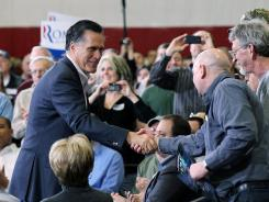 Mitt Romney greets supporters during a town hall style meeting at Taylor Winfield in Youngstown, Ohio.