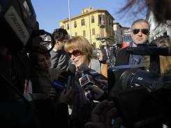 A cruise survivor talks to the media on Saturday in Grosseto, Italy, where the first hearing over the shipwreck investigation took place.