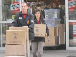 Investigators:  DEA agents at a store in Sanford, Fla., on Feb. 4.