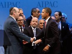 President Obama greets board members at the AIPAC conference Sunday.