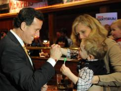 Republican presidential candidate Rick Santorum meets with campaigners on Sunday.