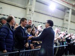 Republican presidential candidate Mitt Romney greets supporters during a town hall style meeting at Taylor Winfield in Youngstown, Ohio.