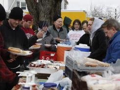 Volunteers come out to feed the town and other volunteers Monday as Henryville, Ind., faces the devastation caused by a tornado last week.