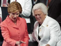 Former first lady Laura Bush, left, joins former first lady Barbara Bush at the Republican National Convention in New York.