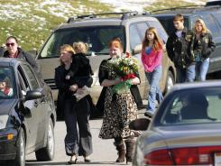 Family and friends arrive at the memorial service for Joseph Babcock, Moriah Brough and children Angel, 15 months, Jaydon, 2, and Kendall, 2 months.