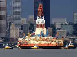 From Alaska to Seattle: A floating oil-drilling platform is moved by tugs in for maintenance.