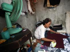 Evie, former nanny of President Obama, irons laundry in her room at a boarding house in Jakarta, Indonesia, on Jan. 27.