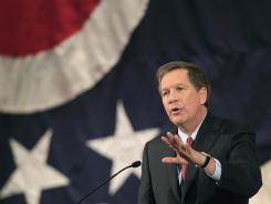 Ohio Gov. John Kasich is reconsidering his position on FEMA aid after tornadoes hit his state. He's shown here giving his State of the State address on Feb. 7.