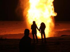 Flames rise from a gas pipeline explosion March 5 in El-Arish, Egypt.