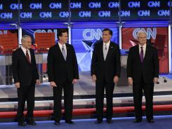 Republican presidential candidates from left, Ron Paul, Rick Santorum, Mitt Romney and Newt Gingrich stand together before the start of a presidential debate in Mesa, Ariz.
