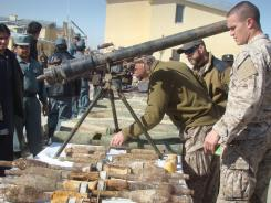 NATO-led forces inspect confiscated arms and ammunition last month in Helmand province. The weakening of the Taliban is critical to the successful, on-schedule withdrawal of U.S. combat troops.