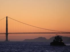 A coast guard ship manuevers near the Golden Gate Bridge in January. Two quakes rattled the San Francisco Bay area Monday.
