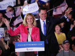 Mitt Romney and his wife, Ann, attend a primary rally in Boston on Tuesday.