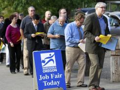 Career fair: People wait to apply for jobs in Portland, Ore. A federal job training law called the Workforce Investment Act hasn't been updated in 14 years.
