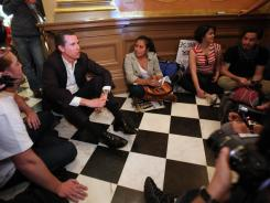 California Lt. Gov. Gavin Newsom, left, sits with protesters to discuss their demands for more funding for higher education during a sit-in against cuts to higher education at the Capitol in Sacramento on Monday.