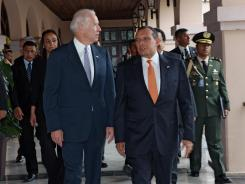 Vice President Biden walks with Honduran President Porfirio Lobo at the presidential palace in Tegucigalpa on Tuesday.
