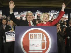 Republican presidential candidate Newt Gingrich and his wife, Callista, wave to supporters after Gingrich was declared the winner of Tuesday's Georgia primary.