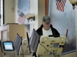 Larry Lewis fills out his ballot Tuesday at a polling station at Steubenville, Ohio, restaurant Froehlich's Classic Corner. Ohio was one of 10 states voting Tuesday, with 66 delegates up for grabs.